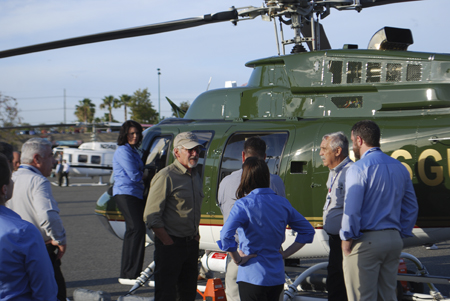 Harrison Ford next to his Bell 407GX helicopter before take-off on the last day of Heli-Expo 2014.
